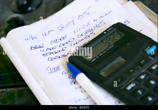 Builders Notepad Used Quotation Stock Photos \ Builders Notepad - builders quotation