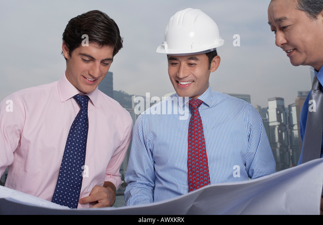 Young Architect Blueprints Hard Hat Stock Photos  Young Architect