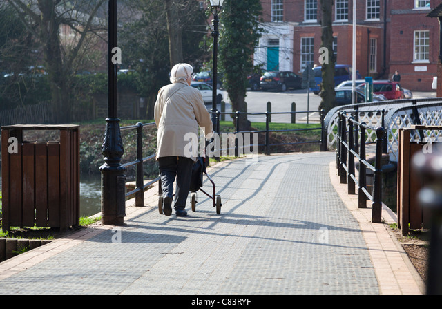 Ladies Wraps Tesco Old Lady And Zimmer Frame Stock Photos & Old Lady And