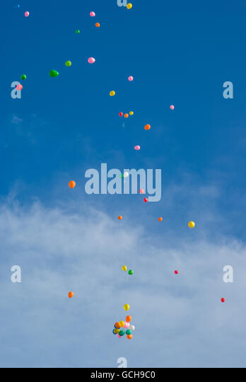 Yellow Balloons Floating In Blue Stock Photos  Yellow Balloons