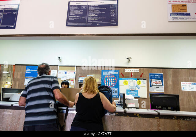 Priority Mail Express International Shipping Usps Travel Agent And Customer Stock Photos And Travel Agent And