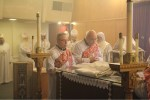 The newly ordained deacons take up their service at the Holy Altar.