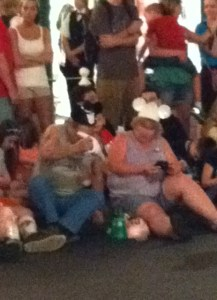 This is a very common scene...tremendously large humans with Mickey Mouse ears on with huge sodas....