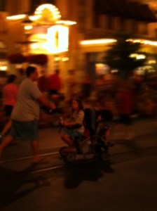 I mean look how much larger she is than the stroller!! If that guy lets go - the whole thing will tip over!