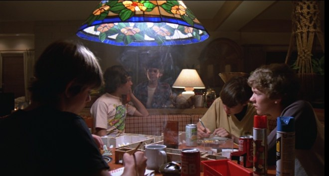 Here, children in the 1980's complete their homework surrounded by TAB and second-hand smoke and zero parental involvement.