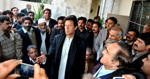 Imran Khan talking with party workers