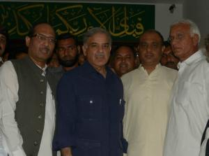 Former Chief Minister Punjab Muhammad Shahbaz Sharif poses for a group photo after meeting with Peoples Party ticket holder Khalid Bashir from NA-92 Gojra, who announce to join PML-N