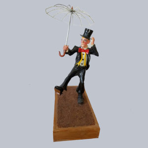 Sonny King - Clown with Umbrella Polymer clay, wood, acrylic paint. 7x3.5x3.5 in. $4,000
