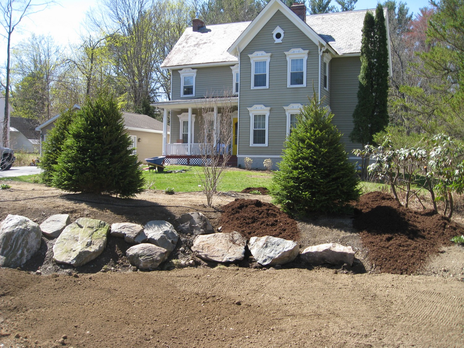 Naturalistic privacy berm delmar ny landscaping and