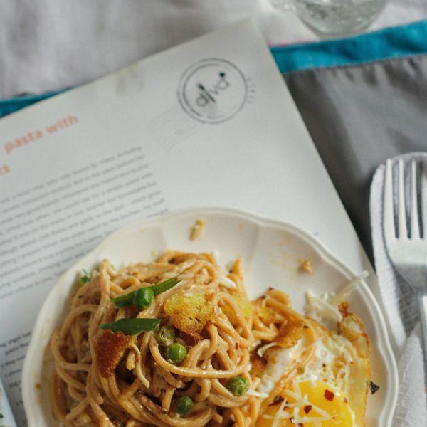 Delicious pasta in a silky rich sauce, a fried eggs and peas. Ready in 20 mins and perfect for a cozy dinner for two.