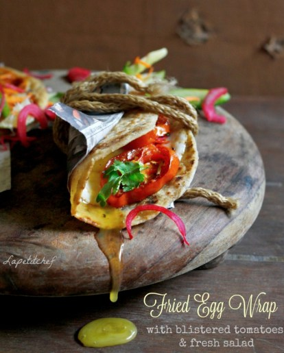 Fried egg wraps served with garlic blistered tomatoes and fresh salad will become one of your favorite breakfast dishes soon. Its fun, fast and fabulous..whats more, its packed full of health and is extremely flavorful