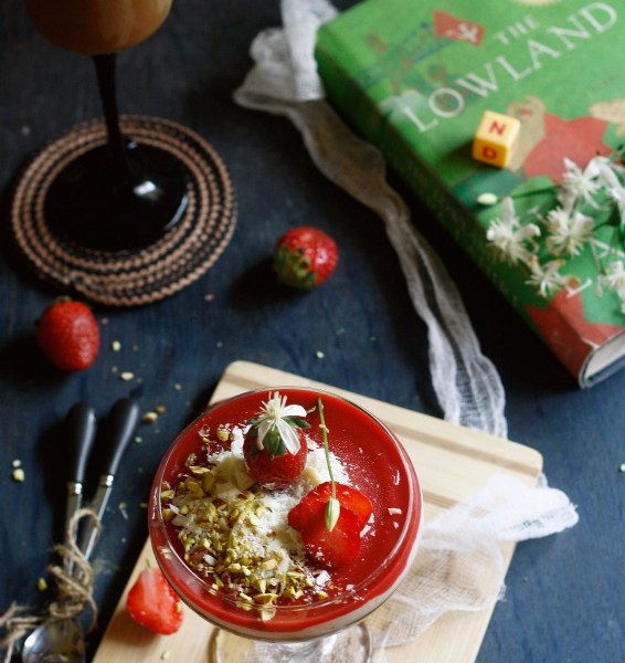A devilishly easy and sinful chocolate pannacotta with white chocolate ganache,strawberry coulis and salted pistachios