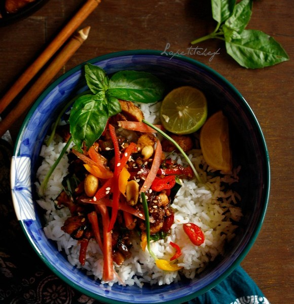 Thai basil chicken is the easiest and most delicious way of eating chicken. Fragrant from basil and hot from red dragon chillies, this chicken dish is ready in a jiffy! Perfect for weeknights which demand fast & fabulous food. Pair with Thai sticky rice for utter and total gastronomic bliss.