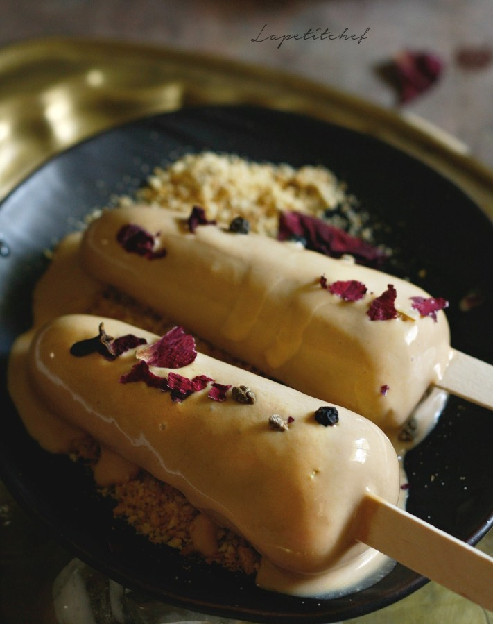 masala chai kulfi -The ever loved masala chai( spiced tea) gets a summer makeover with this easy and delicious kulfi(popsicle). Served here over some biscuit crumble and a bourbon chocolate syrup to make this perfect for fabulous entertaining!