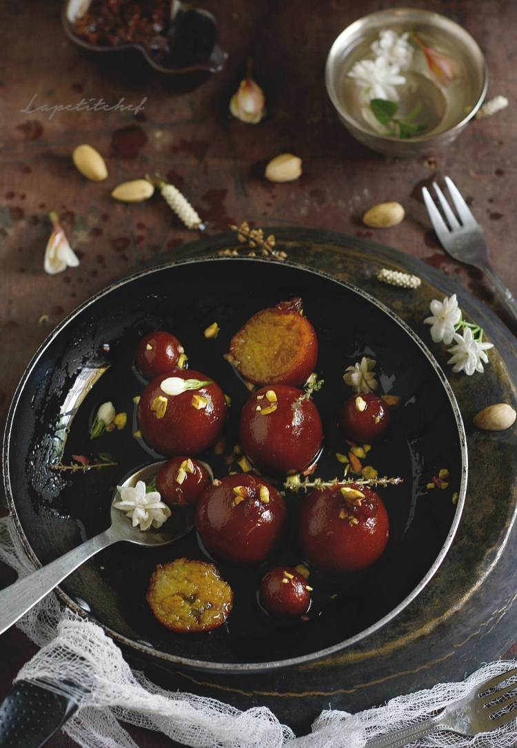 Gulab jamun is a must have Indian dessert. These doughnuts are stuffed with khoya and soaked in a saffron,rose water syrup and Old Monk sugar syrup, making these gulab jamun a dish worthy of the royals.