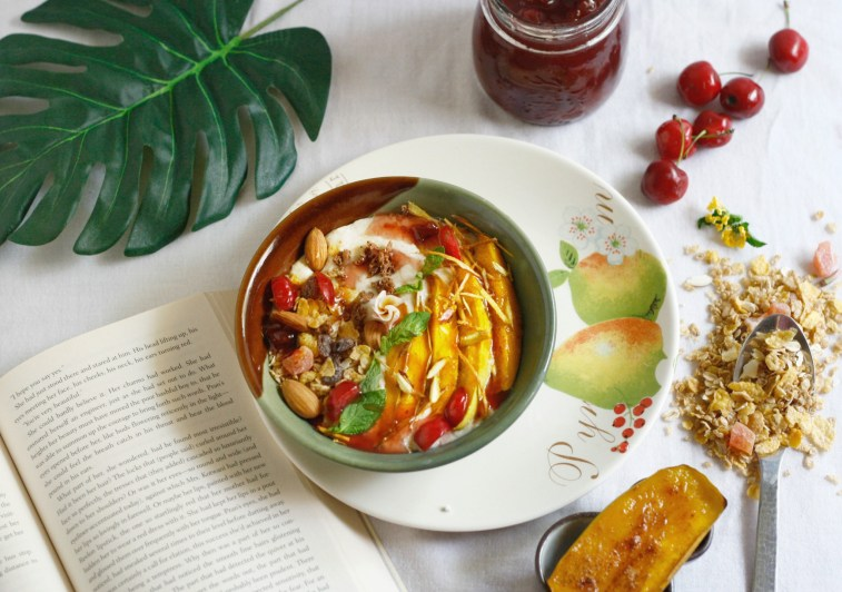 Make this delicious Overnight Oats bowl cooked in coconut milk and topped with bruleed mangoes and cherry compote.
