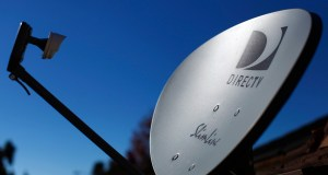 A DirecTV satellite dish is seen on a residential home in Encinitas, California in this file photo taken November 5, 2014. DirecTV, the No. 1 U.S. satellite TV provider, reported a 6.3 percent rise in third-quarter revenue as it earned more from each subscriber in the United States.  REUTERS/Mike Blake/Files  (UNITED STATES - Tags: ENTERTAINMENT BUSINESS TELECOMS)