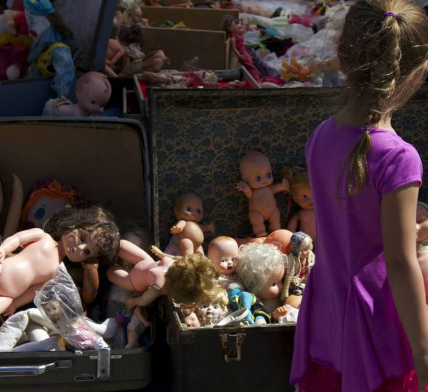 A young girl deciding whether she is disturbed or in love with the surplus of dolls. (Photo by Niko LaBarbera)