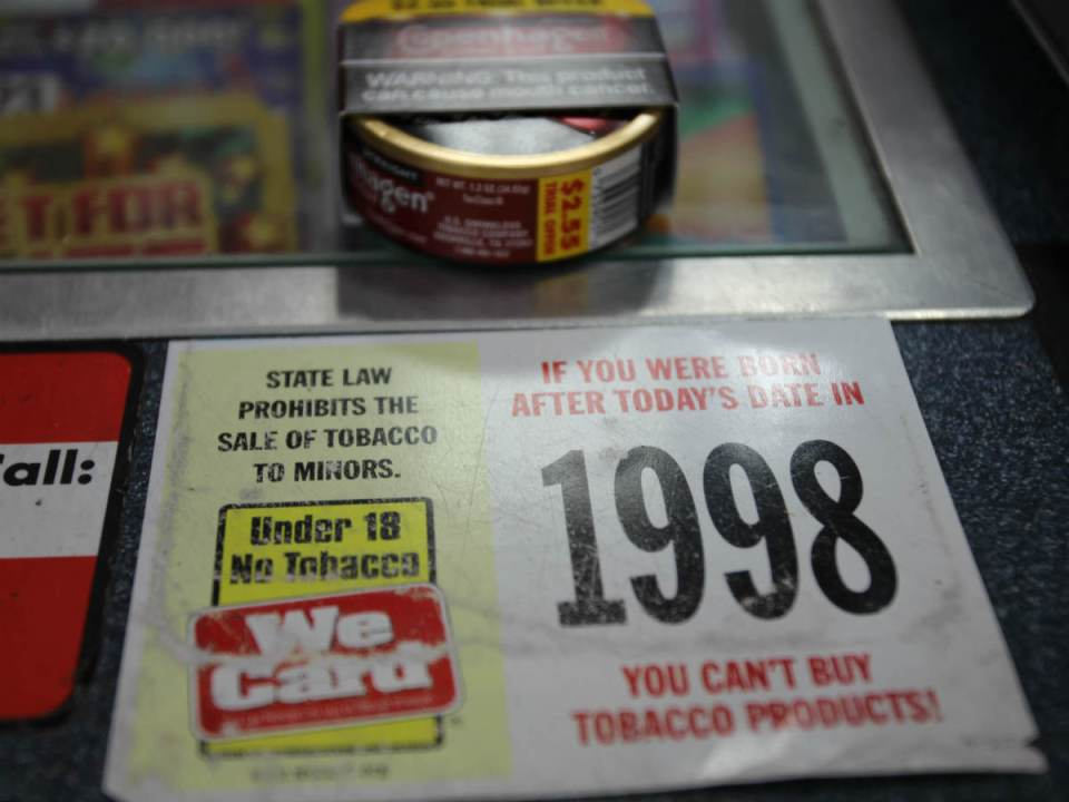 This sticker is placed where ever tobacco products may be bought. Fines for violating this law can be up to $75 and 30 hours of community service. (Austin Weatherman/ Lariat)