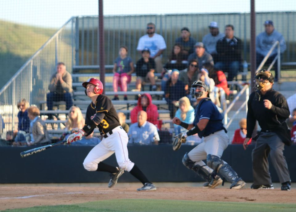 Saddleback's sophomore catcher Dallas Dey (No. 3)watches his hit during Thursday's game against Cypress College. The Gauchos are currently tied with Cypress for second place in the Orange Empire Conference. (Nick Nenad/Lariat)