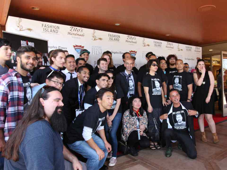 """Saddleback College's film program gathers together, showing off their """"Tri Nguyen"""" t-shirts. Tri Nguyen's family was given a standing ovation during the showcase showing support in the passing of their family member. (Austin Weatherman/ Lariat)"""