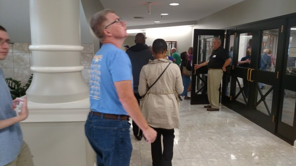 Voters file-in as teh doors open for the first day of early voting in Fishers