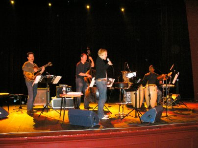 photo of Larry Koonse with Aga Aaryan, Darek Oles, and Munyungo Jackson performing on stage
