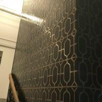 Bronze fretwork interior wall panelling | Custom Designs