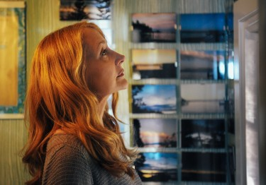 Celia Green (Patricia Clarkson) looks at her collection of sunset photos in LAST WEEKEND.