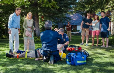 The family looks on after Hector Castillo (Julio Oscar Mechoso) suffers a serious accident in the lake.