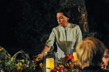 Housekeeper Maria Castillo (Julie Carmen) arranges the dinner table in LAST WEEKEND.