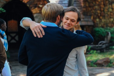 Theo Green (Zachary Booth) and Roger Green (Joseph Cross) say goodbye in LAST WEEKEND.
