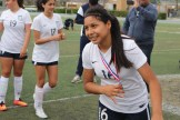 Freshman Ashlynn Gonzalez, the only scorer of the game, receives her championship medal.