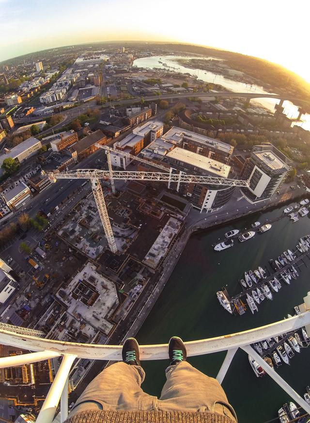 British man climbs construction crane