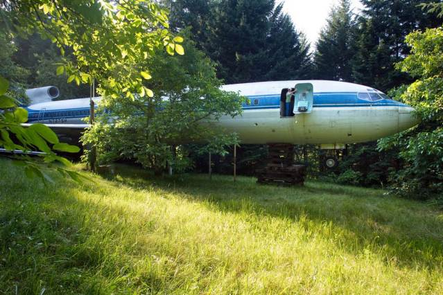 Oregon Man in a Retired Boeing 727 Airliner That is Parked in the Woods