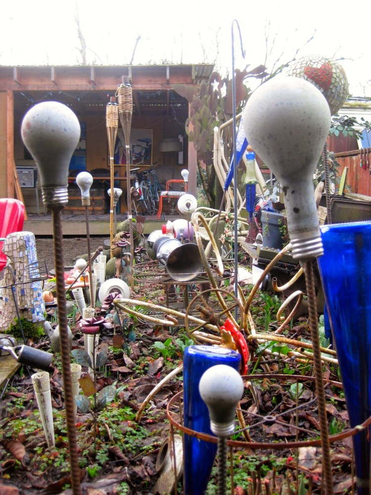 How to make a whimsical cement light bulb ornament for a lawn or garden - Cement cloth garden ornaments ...