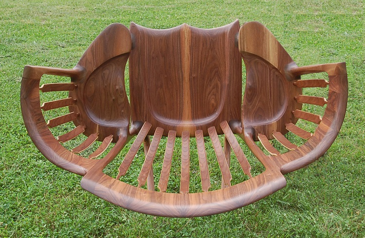 A wooden three seater storytime rocking chair designed by a dad whose lap wasn t big enough