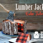 A Lumberjack Tree Trunk Cake With an Edible Axe on Top and a Tasty Plaid Pattern in the Middle