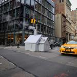 Artist Installs Tiny Wooden Houses Over NYC Steam Vents to Replace the Usual Industrial Orange Tubes