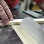 Carpenter Cuts Through Wood With a Saw Blade Made From a Single Sheet of Paper