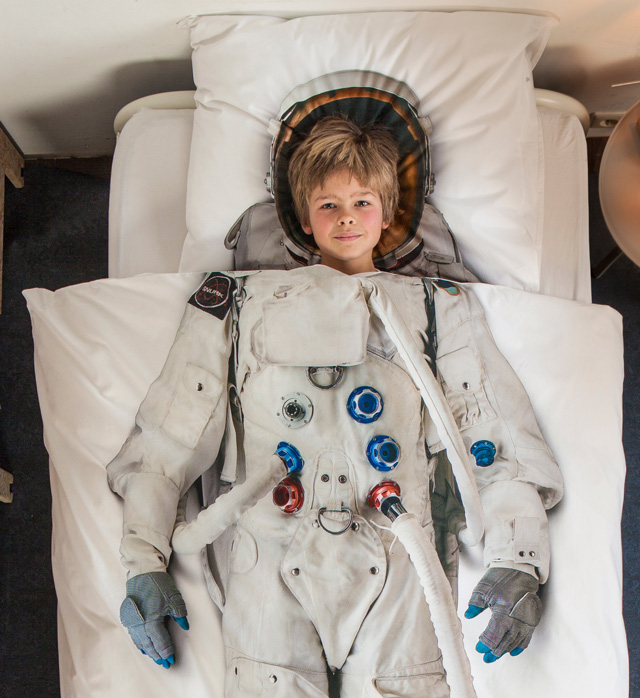 astronaut with boy inside