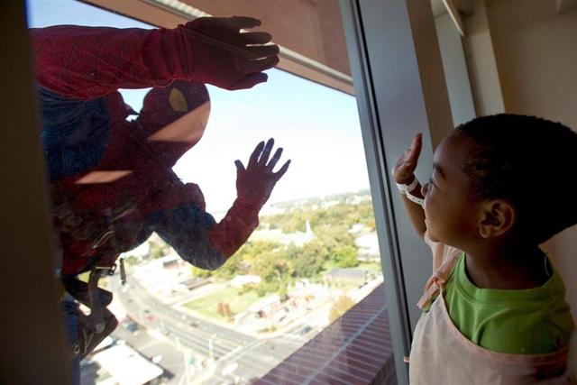 Superhero Window Washer photo by Brandon Dill / AP
