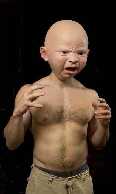Giant baby masks by Landon Meier