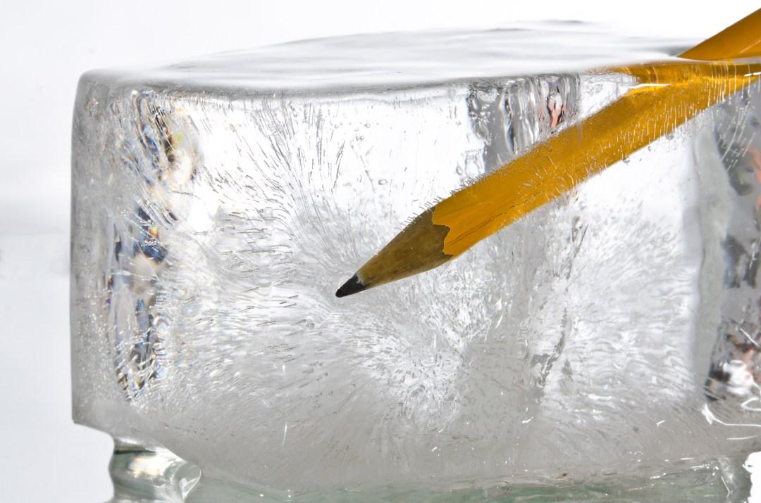 ice cube with pencil symbolizes writer's block