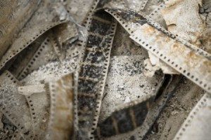 Image of old clips of film laying on the floor.
