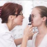 Woman having her eyes examined.