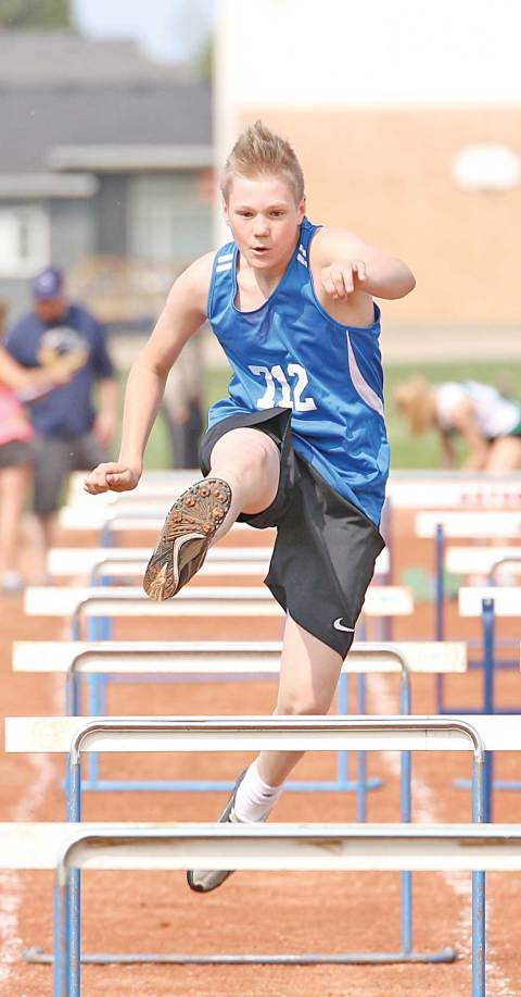 Davidson's Ethan Schilling runs the bantam boys 80-metre hurdles event at the east sectional track and field meet in Outlook on Wednesday.