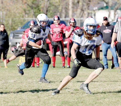 Davidson's Rylan Slemming (left, filling in as running back) and Cole Murfitt head up the field during the Oct. 15 game in Assiniboia.