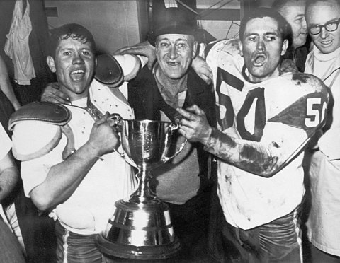 "Cliff (51, left) and Wayne Shaw (50) pose with their father Edwin ""Mud"" Shaw after winning the Grey Cup with the Saskatchewan Roughriders at Vancouver's Empire Stadium on Nov. 26, 1966."