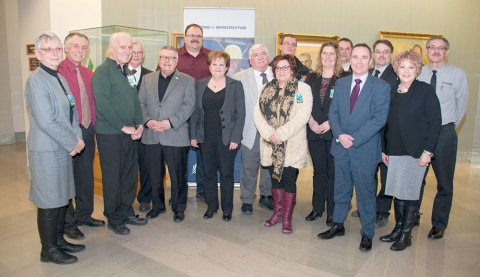 Craik Mayor David Ashdown (at centre, in grey suit) joined with other mayors from across the province for Wednesday's funding announcement.